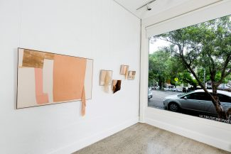 Installation view of abstract textile artworks at Barometer Gallery