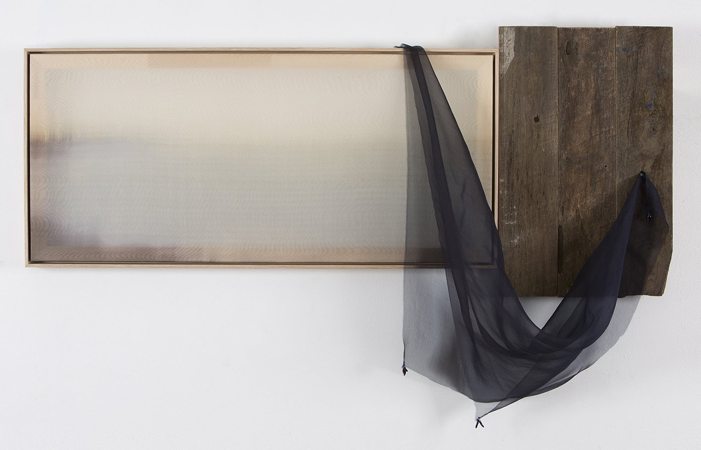 Example of recent art-making - Image of a landscape photograph on silk, assembled with a panel of used floor boards and draped indigo silk